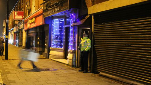 An officer guards a unit in Birmingham reportedly linked to the London attack. (AAP)