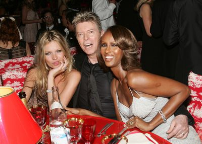 Hanging out with close pal David Bowie and Iman at the 2005 CFDA Awards dinner in New York.