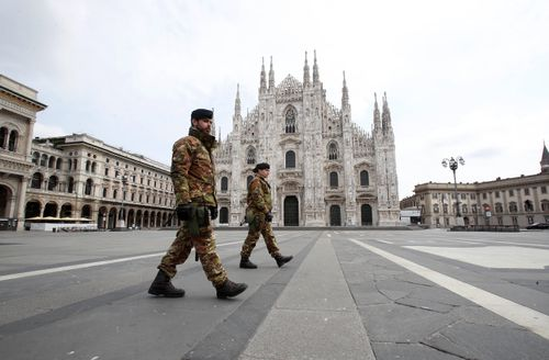 Italian soldiers patrol the square facing Duomo gothic cathedral in downtown Milan, Italy.