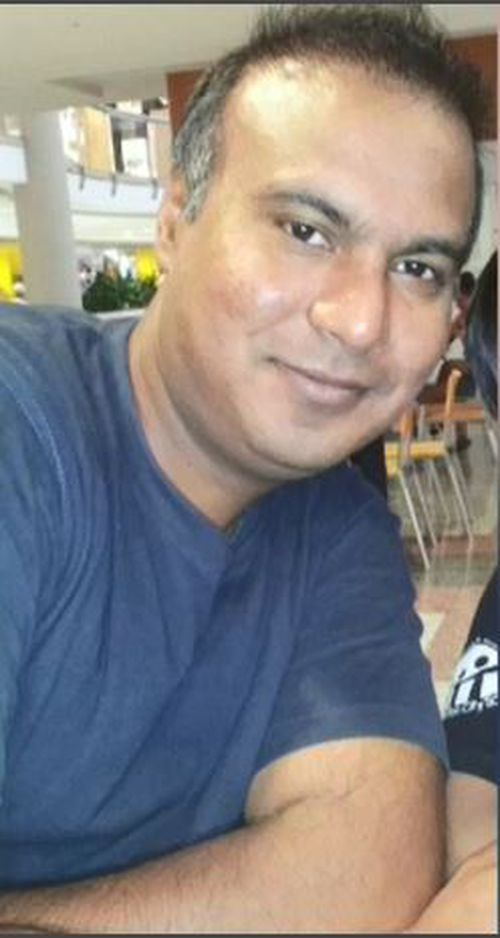 Father-of-two Zeeshan Ahmed,44, remains in an induced coma in hospital after a cowardly attack outside of his Lakemba home overnight. Picture: Supplied.