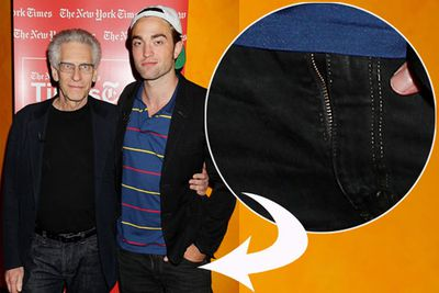 As if he didn't feel exposed enough already, poor R-Pattz must have been so distracted by the heartache caused by his cheating girlfriend Kristen Stewart, he forgot to check his fly before posing at the premiere of his movie <i>Cosmopolis</i>.