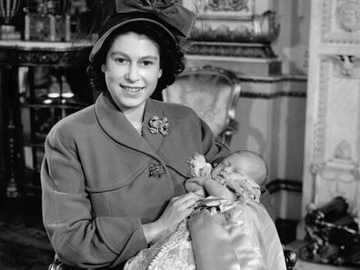 Princess Elizabeth, now the Queen, with Prince Charles on his christening day, 1948.