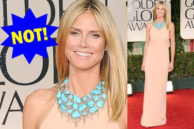 We're seeing some pretty stones and that's about it. Not even Heidi Klum can pull off a shapeless, nude gown and a nude face.