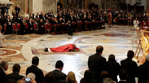 Pope Francis lies down in prayer during the Good Friday Passion of Christ Mass inside St. Peter's Basilica, at the Vatican. (AP)
