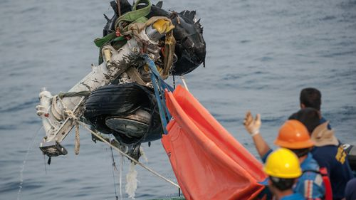 Rescuers use crane to retrieve part of the landing gears of the crashed Lion Air jet from the sea floor in the waters of Tanjung Karawang, Indonesia