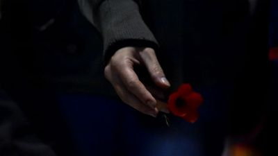 Visitors lay poppies after the dawn service. (AAP)