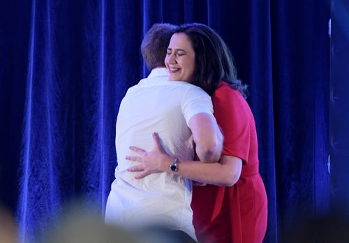 Jeff Horn hugs Ms Palaszczuk after introducing her at the campaign launch today. (AAP)