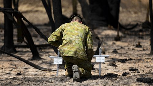 Lieutenant Kynan Lang from the 10th/27th Battalion reflecting at the scene where his uncle and cousin died during a bushfire on Kangaroo Island.