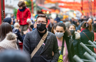 People on the street wearing facemasks