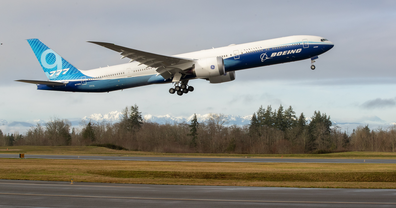 A Boeing 777X landS at Boeing Field in Seattle, after its first flight on Saturday, Jan. 25, 2020. According to Boeing, the 777X features large carbon-composite wings, the largest Boeing has ever designed