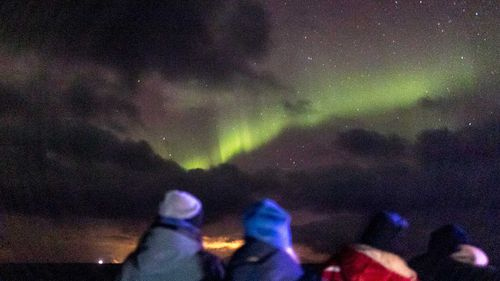 The northern lights on a very late evening in Vestfjorden.