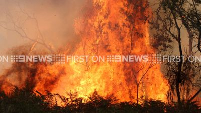 The bushfires, which are threatening a further 200 homes, began after a controlled burn jumped containment lines.
