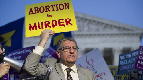 Operation Rescue founder Randall Terry protests in front of the Supreme Court in Washington. (AAP)