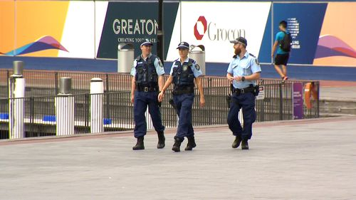 NSW Police patrol a deserted area by Sydney harbour. The city is under tight social distancing restrictions.