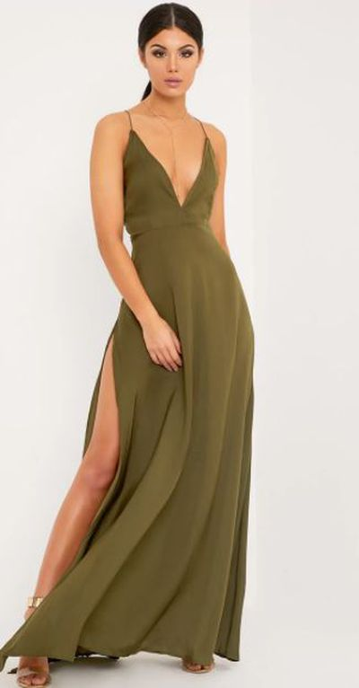 "<a href=""https://www.prettylittlething.com/beccie-khaki-extreme-split-strappy-back-maxi-dress.html"" target=""_blank"">Pretty Little Thing Beccie Khaki Extreme Split Strappy Back Maxi Dress, $50.</a>"