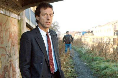 """Dirty"" Den Watts (Leslie Grantham) was the original villain on this long-running British soap, constantly making life miserable for regulars of the Vic. He was killed off in 1989 after running afoul of a criminal organisation... only to resurface 14 years later, revealing that he'd actually faked his death and had been on the run in Spain the whole time. <br/><br/>""Hello princess,"" were the famous first words he said to his shocked daughter Sharon after his rise from the grave.<br/><br/><B>WTF rating:</B> &#9733;"