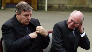 Cardinal George Pell and John Howard in 2004.