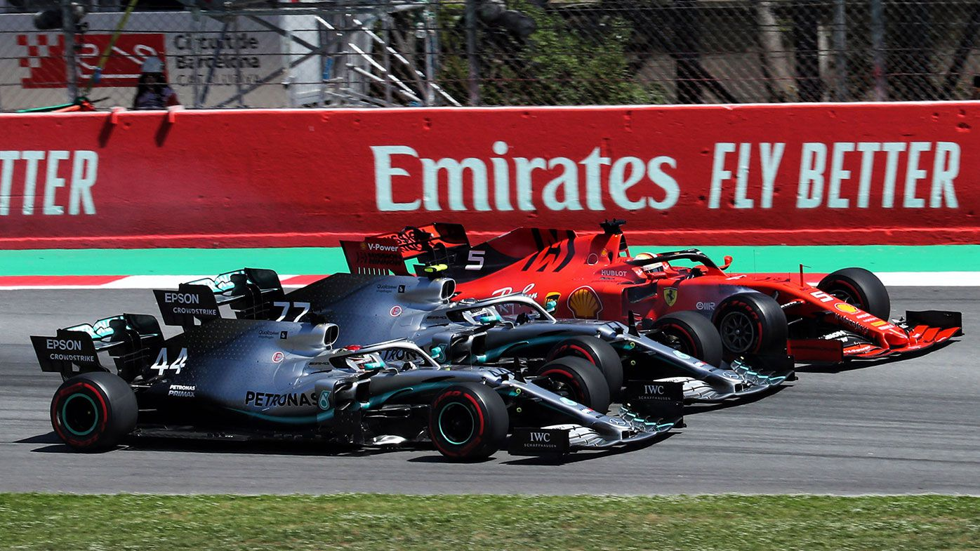 Lewis Hamilton (44), Valtteri Bottas (77) and Sebastian Vettel (5) at the first corner of the Spanish GP.