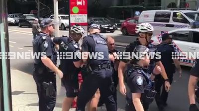 Young scooter riders clash with police after wreaking traffic havoc