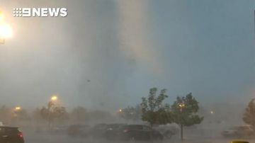 Tornado drags cars and uproots trees as it rips through US car park