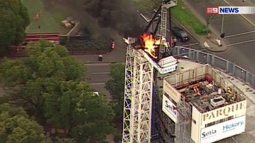 The crane caught fire at around 3.30pm. (9NEWS)