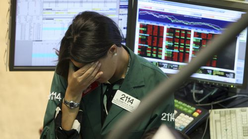 A specialist with Lehman Brothers works her post on the trading floor in September 2008. (AAP)