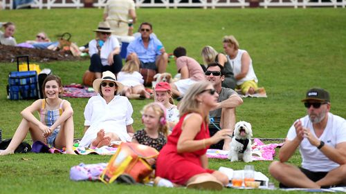 People enjoy a Mother's Day picnic in Brisbane, Sunday, May 10, 2020.