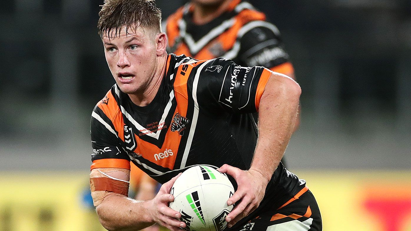 Harry Grant of the Wests Tigers runs the ball