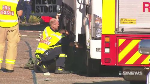 Emergency crews inspect one of the trucks involved in the crash. Picture: 9NEWS