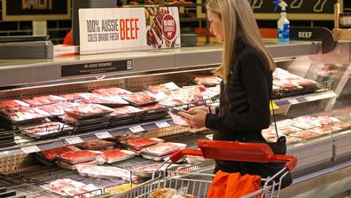 Coles staff work to keep shelves stocked.