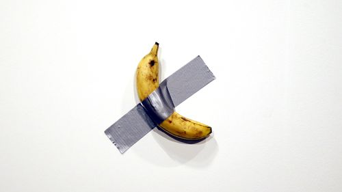 Italian artist Maurizio Cattelan's piece 'Comedian' (a banana duct taped to the wall) is shown during Art Basel in Miami, Florida, USA.