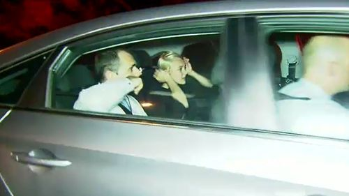 Katie Anne Corben is taken into police custody.