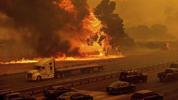 Flames from the LNU Lightning Complex fires jump Interstate 80 in Vacaville, California. California Wildfires