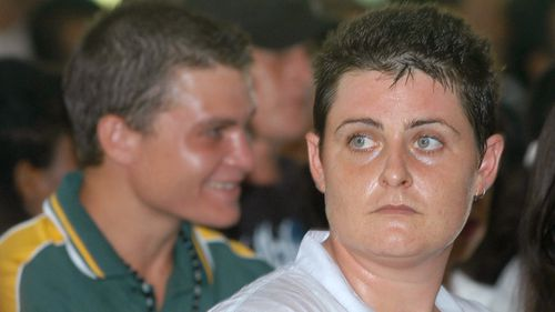 Australian Renae Lawrence, right, and Scott Rush, left, join other prisoners to celebrate Christmas at Kerobokan prison in Bali, Indonesia, Monday, Dec. 18, 2006.