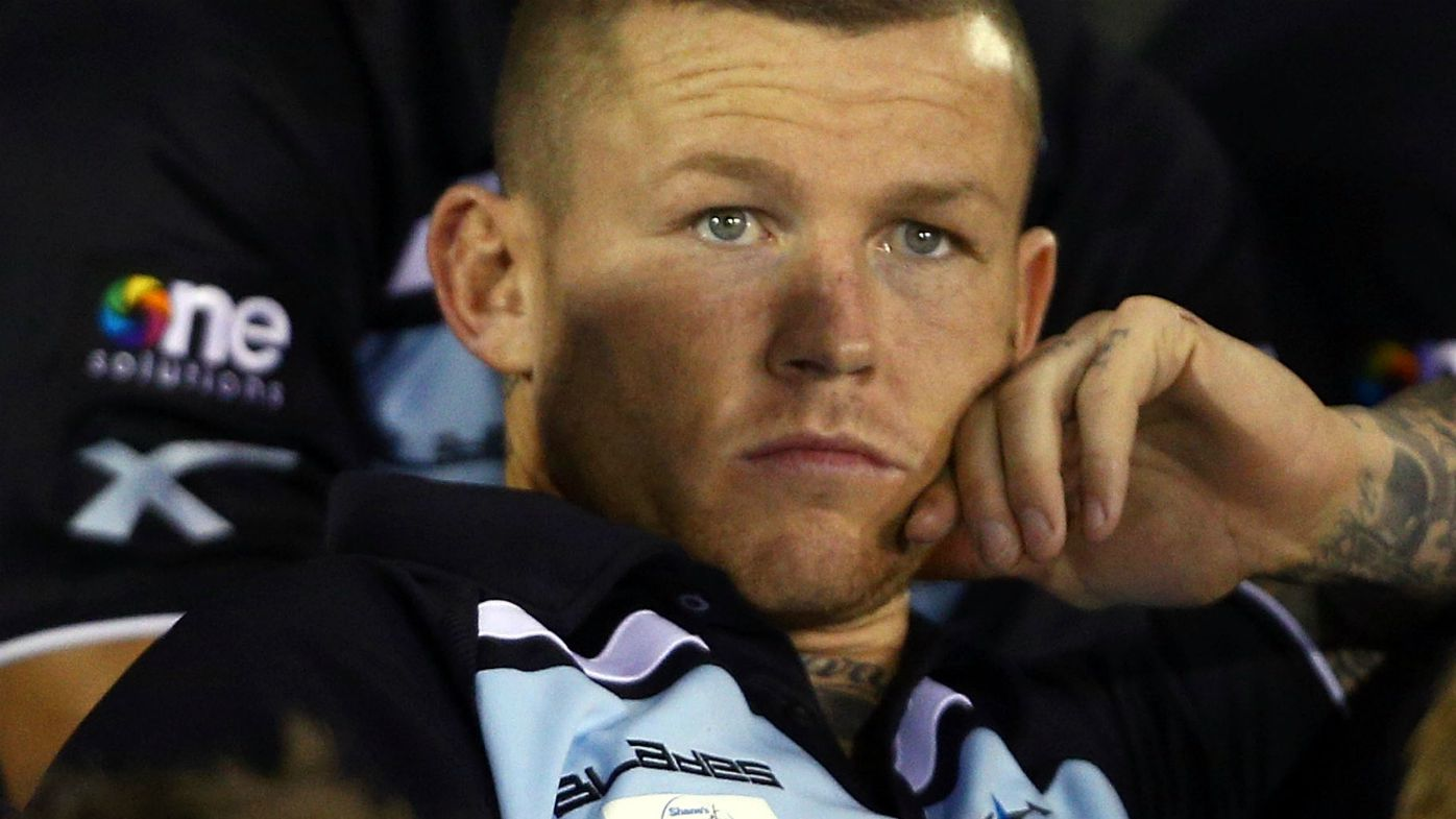 Todd Carney watches on