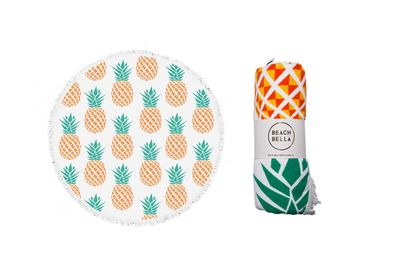 "<strong>Beach Bella <a href=""http://www.beachbella.com.au/shop-2/pineapples/"">round towel in 'Pineapples'</a>, $84.95</strong>"