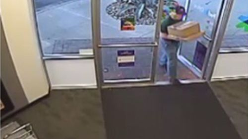 CCTV shows images of a 'person of interest' going into a FedEx store. (Supplied)
