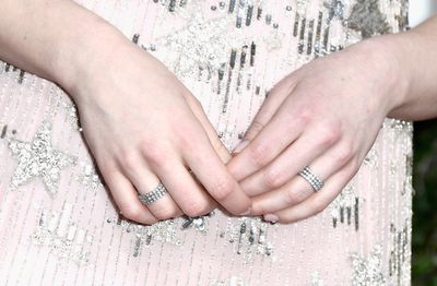 <p>The perfect sparkling stars of Emma Stone's Valentino gown were highlighted by two simple diamond bands.</p> <p>Image: Getty.</p>