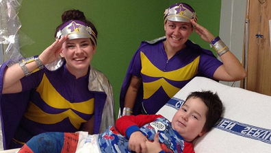 In hospital being visited by Starlight Children's Foundation workers.