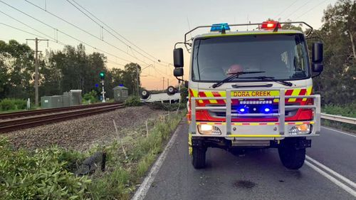 Crews from the Dora creek Rural Fire Brigade attended the scene to assist in removing the vehicle.