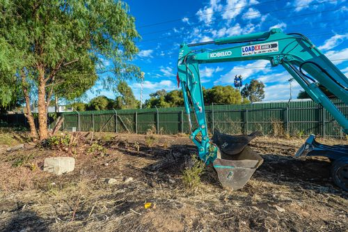 A digger is seen at the site of a factory in Plympton, Adelaide, Friday, February 2, 2018. (AAP)