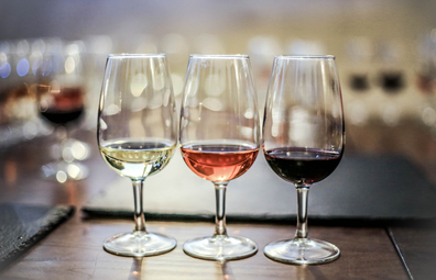 Wine tasting: glasses of white, rose and red wine