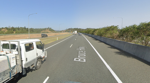 Queensland police seeking witnesses after man's body found 100 metres from his bike on Bruce Highway