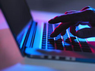 Man on computer at night