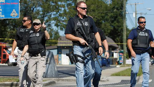 Florida suburb gripped by fear of serial killer gunman