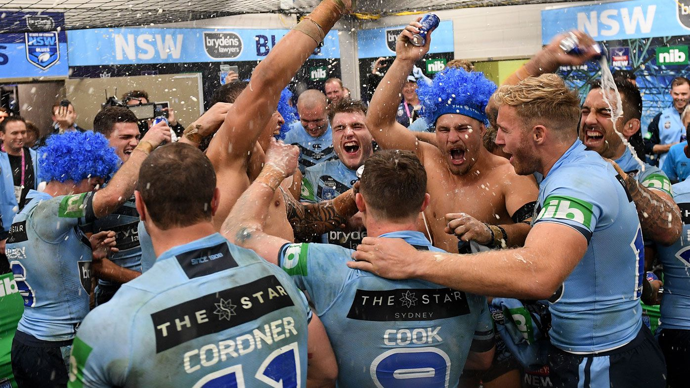 The NSW Blues celebrate Origin victory.