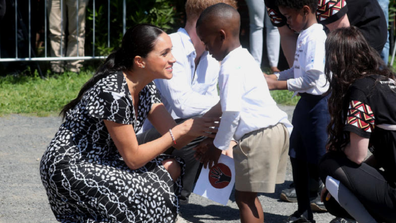 Meghan Markle greeted in Nyanga at their first official engagement.