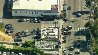 Woman killed in LA hostage standoff 'was shot in crossfire'
