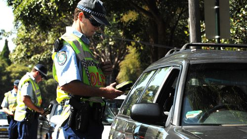 NSW Police conduct a random breath test operation on Moore Park Road, Sydney