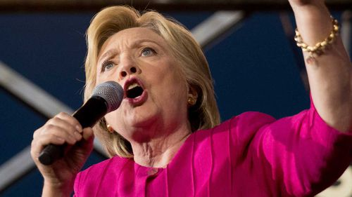 Clinton releases tax return, blasts Trump for not doing so